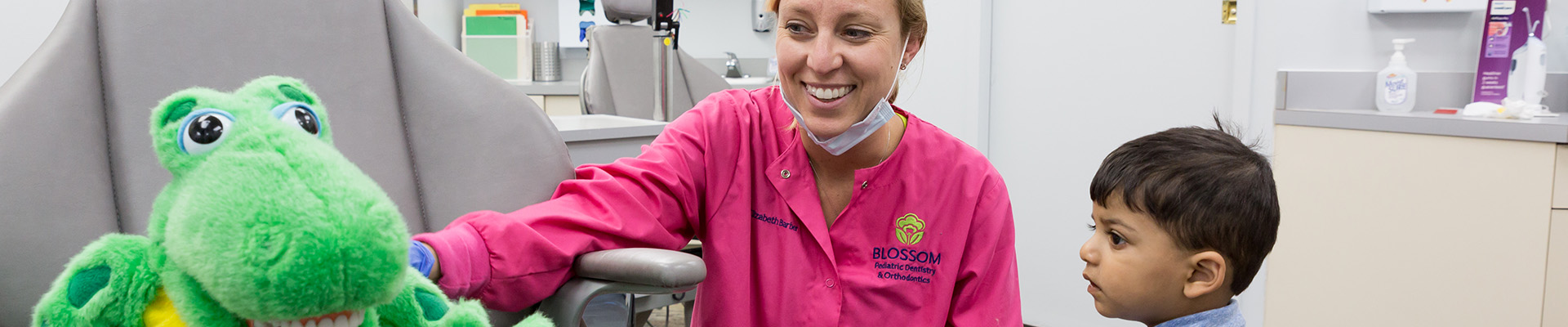 Dr. Elizabeth Malette Barber with young boy patient at Blossom Pediatric Dental and Orthodontics